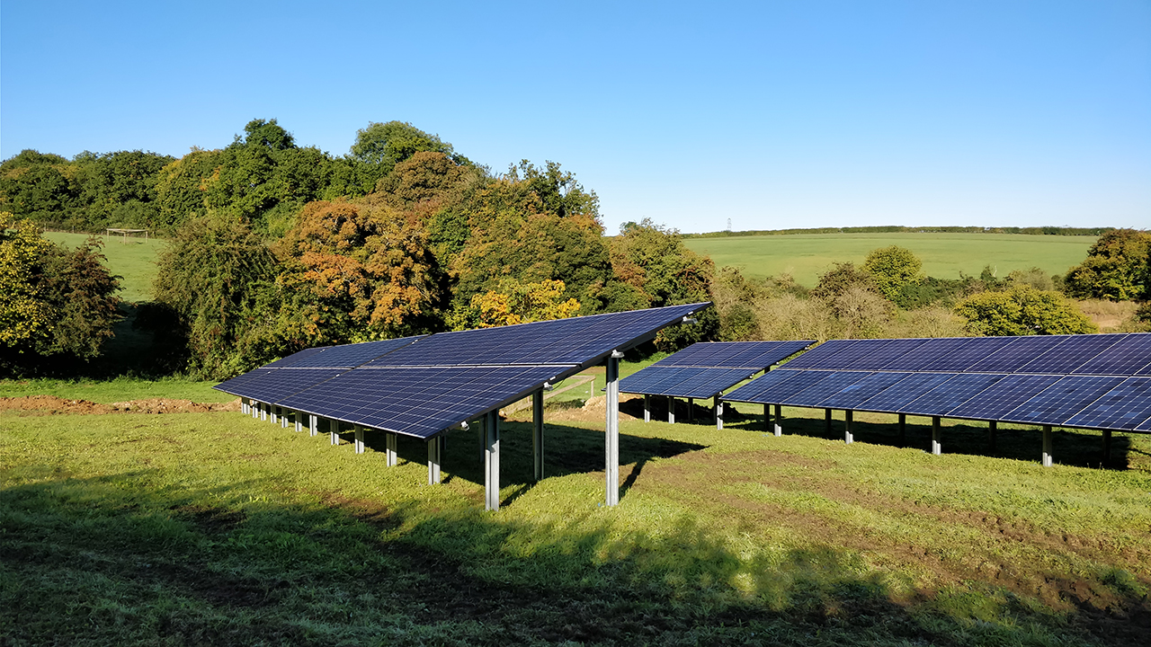 Ground mounted solar panel array in field